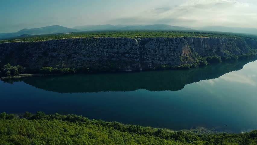 Copter aerial view of the Brljan lake with steep cliff located on the exit from canyon of Krka River. | Shutterstock HD Video #7199383
