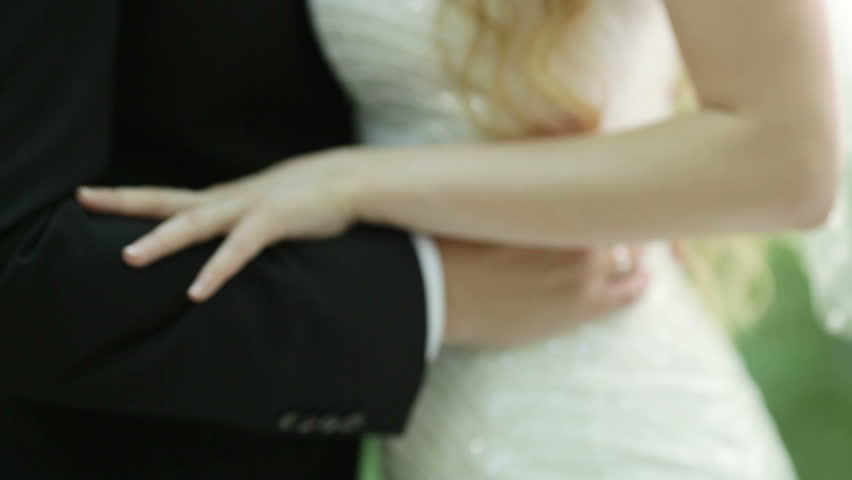 Groom embraces the young bride | Shutterstock HD Video #7200418
