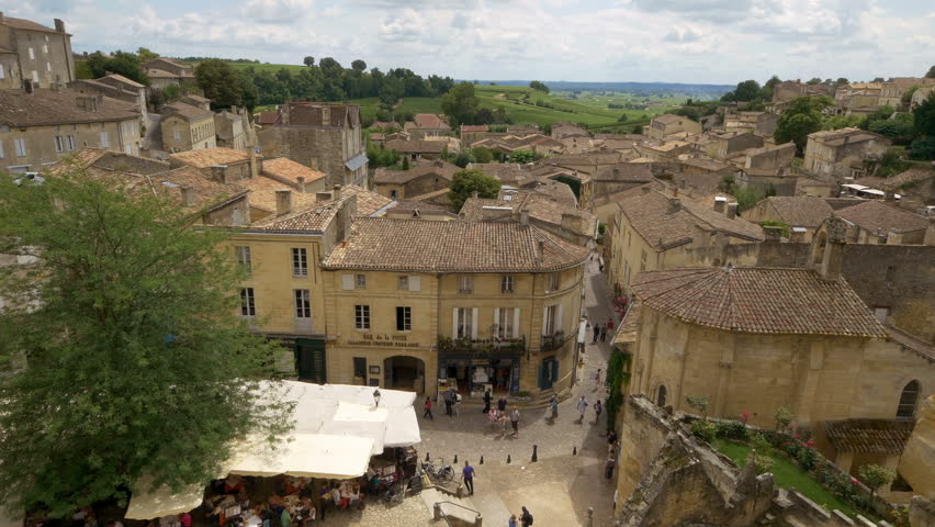 SAINT EMILION FRANCE - JULY 2014: Looking down on Place de L'eglise Monolithe in the center of the town. This area is full of restaurants and shops. Saint Emilion is one of the principal red wine areas of Bordeaux.