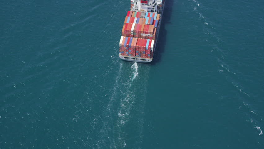 Aerial shot of container ship in at sea near Los Angeles container shipping Port - HD stock video clip