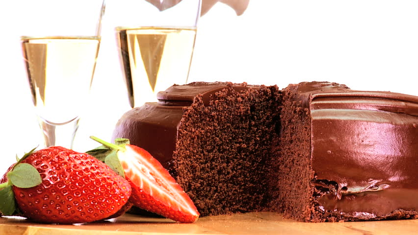 Indulgent sticky chocolate cake served with fresh strawberries & sparkling white wine - HD stock video clip