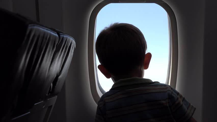 Little child looking out the airplane window