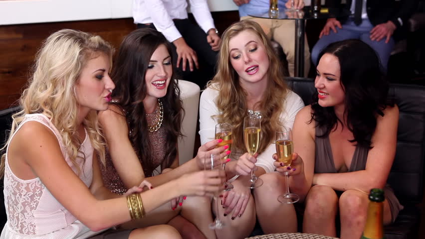 Female friends enjoying champagne together at the nightclub - HD stock video clip