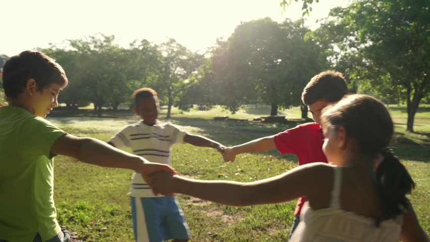 Hispanic and african american little boys and girls playing ring around the rosie in city park and holding hands. Young kids, friends, people, recreation, summer camp fun. Slow motion. 7of18 - HD stock footage clip