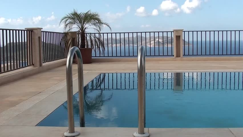 Beautiful view on the pool and the sea - HD stock video clip