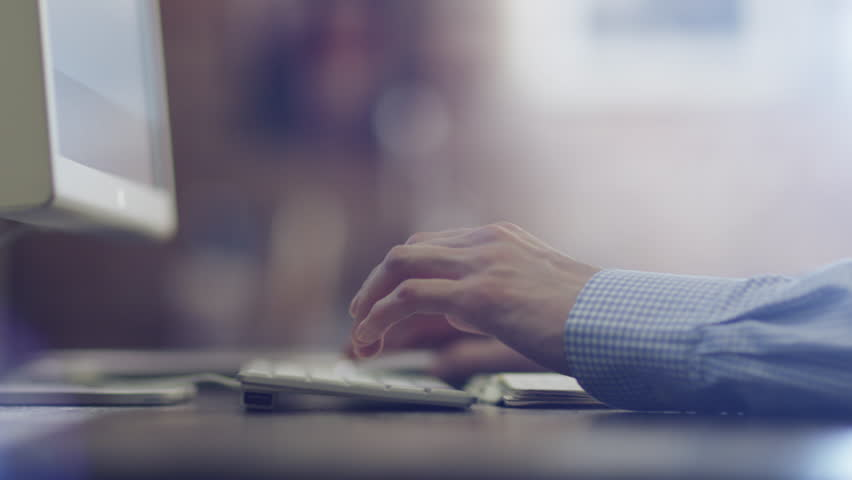 Designer Typing a Message at Evening. Shot on RED Camera in 4K, so you can easily crop, rotate and zoom, without loosing quality. ProResHQ codec- Great for editing, color correction and grading.