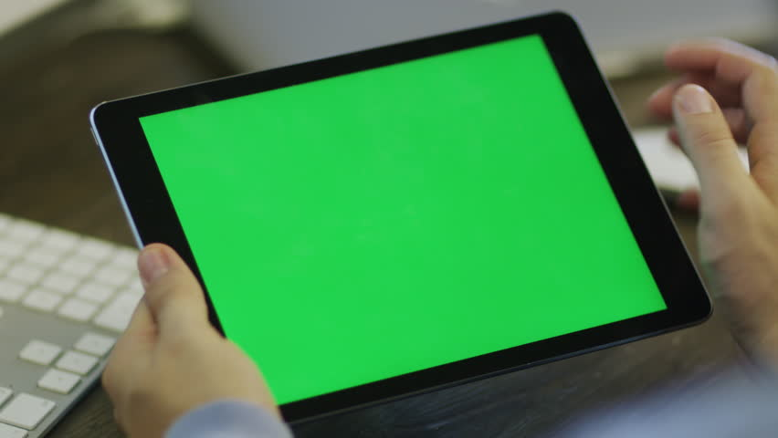 Designer using Digital Tablet with Green Screen at Work in Landscape Mode Shot on RED Camera in 4K, so you can easily crop, rotate and zoom. ProResHQ codec  - Great for editing, color correction | Shutterstock HD Video #7315447