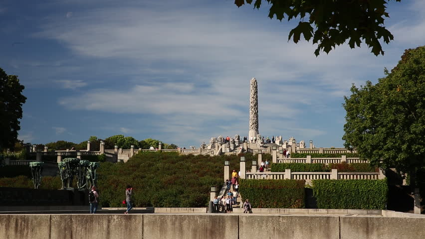 VIEW OF THE MONOLITH VIGELAND PARK OSLO NORWAY - 15 SEPTEMBER 2014: slow slider movement tourists walking the Monolith in background