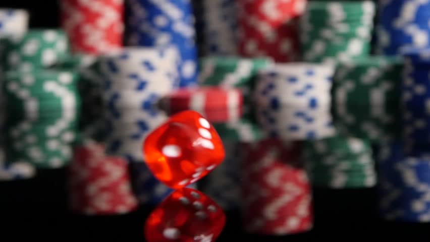 Throwing red dice on the background of poker chips in the casino. Slow motion - HD stock footage clip