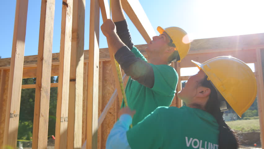 Volunteers working together on construction project
