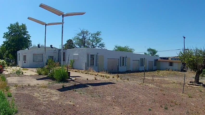 SELIGMAN, AZ/USA: July 21, 2014- A wide shot of an old motel re-purposed as cheap apartments in a small rural town  circa 2014 in Seligman- the birthplace of Historic Route 66.
