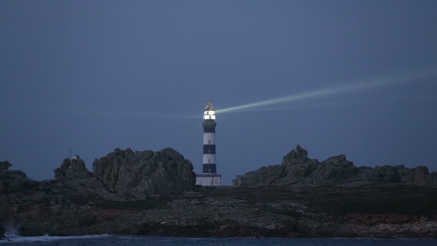 Creach lighthouse illuminated in evening, the most powerful in the world, Ushant island (aka Ouessant), Brittany, France - HD stock video clip