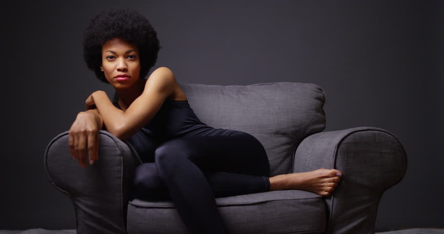 Black woman sitting in armchair stock footage video for Sitting in armchair