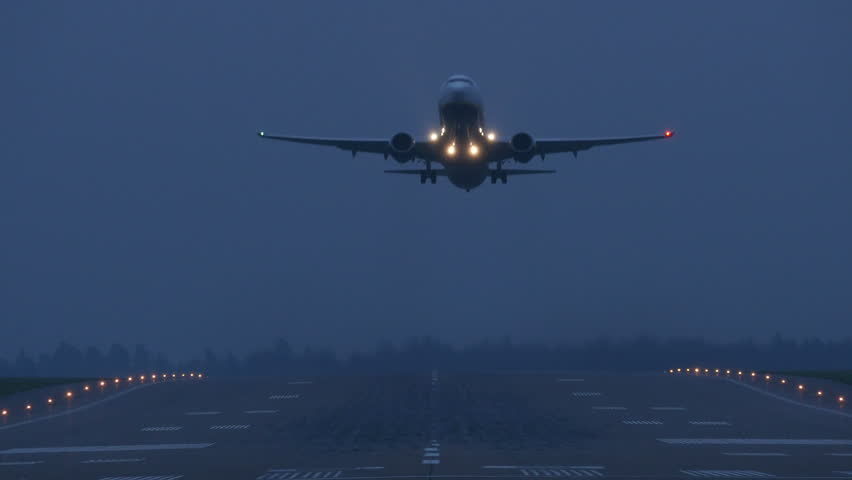 Airliner taking off on a dark morning, 4k.