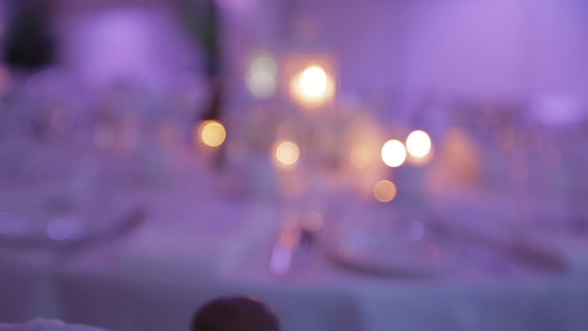 Decorative table setting pan with candle lights at a wedding reception. 1080p HD.
