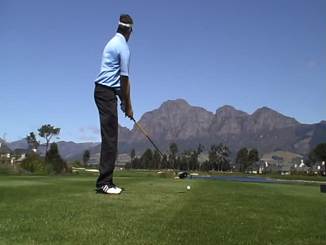 Man playing golf on a beautiful golf course - SD stock video clip