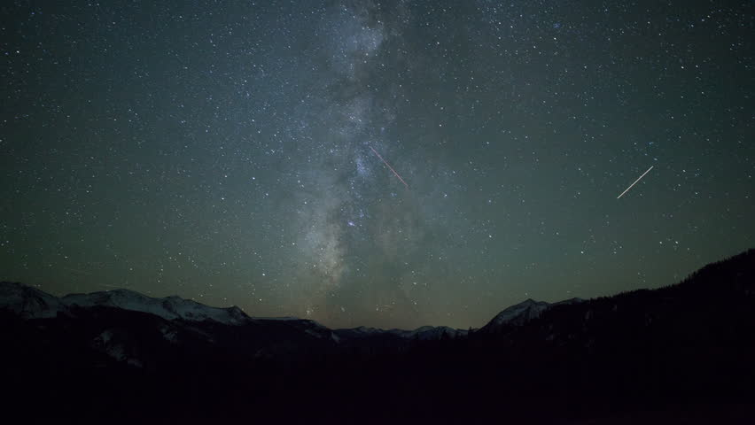 4K time lapse of Milky Way Galaxy stars over snow capped Rocky Mountains in Colorado on a clear calm night