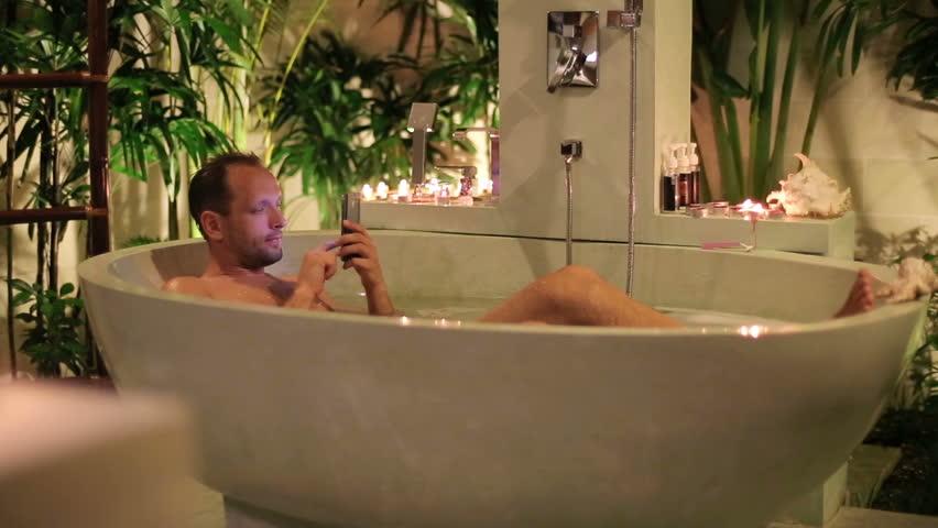 Man Texts In Bathtub Stock Footage Video 2921956