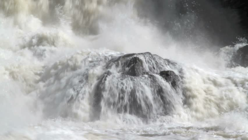 Spring flood water rushing down the falls and crashing on the rocks. Great Falls,Androscoggin River Maine