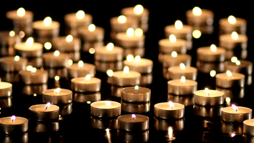 Many Candles light on black background. | Shutterstock HD Video #7449349