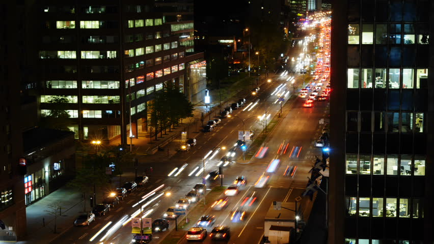 Montreal Rene Levesque Boulevard  At Night With Heavy Traffic Time Lapse