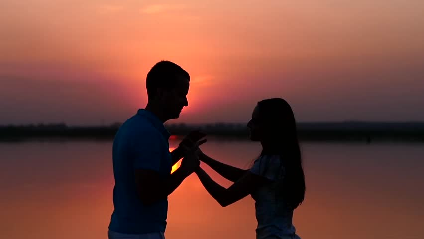 Silhouette Man And Woman Dancing At Sunset. Slow Motion ...