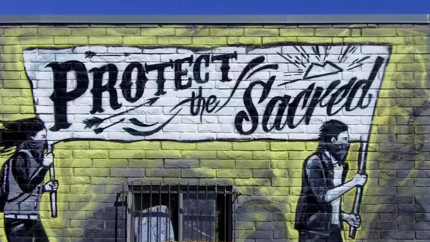 "FLAGSTAFF, AZ/USA: Sept. 7, 2014- A mural, sign or painting on a Native American Indian thrift store proclaims the message ""Protect The Sacred"" circa 2014 in Flagstaff.  - HD stock video clip"