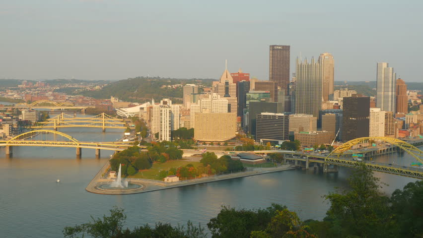 A view of the downtown area including the skyline, bridges, and Point State Park at the confluence of the Allegheny and Monongahela Rivers in Pittsburgh, Pennsylvania. - 4K stock footage clip