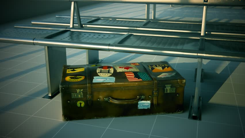 01763 Suitcase With World's Famous Travel Destinations Labels At Airport