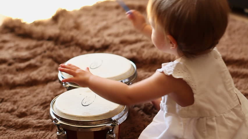 Beautiful girl playing the drums, slow motion