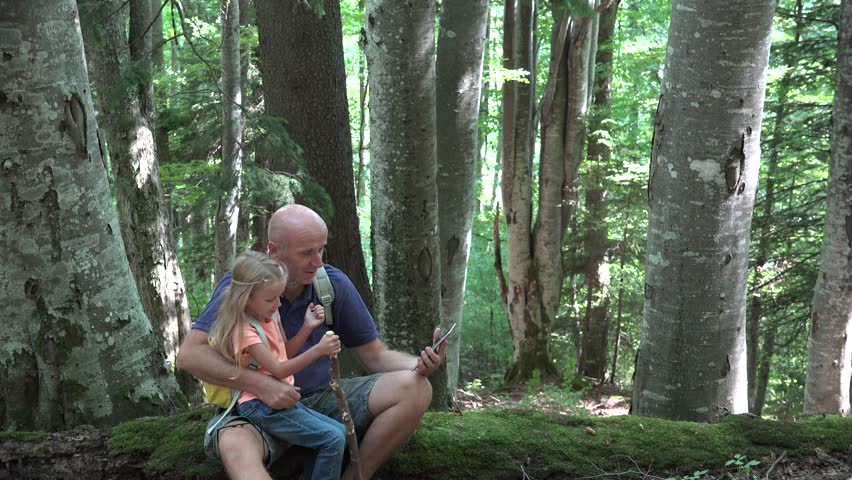4K Father, Child Taking Selfie on Tablet PC, Happy Smiley Family Relaxing, Playing with Touchscreen in a Mountains Trail, Path, Little Girl and Daddy in Summer Vacation, Trip, Camping - 4K stock footage clip