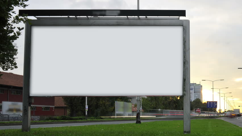 Billboard on highway by day.