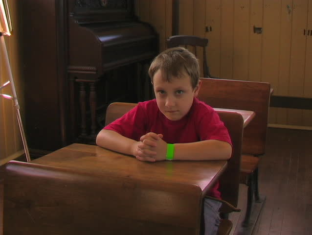 A STUDENT OFFERS AN ANSWER IN A CLASSROOM SETTING. - SD stock video clip