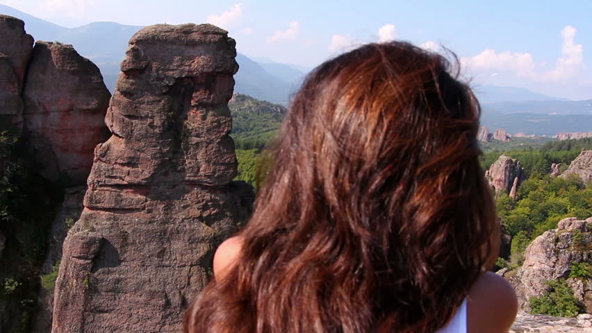 Woman sitting on a rock and admiring the beautiful Belogradchik valley   Shutterstock HD Video #7625128
