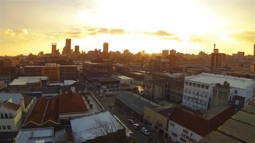 City skyline during sunset with clouds timelaps | Shutterstock HD Video #7626172