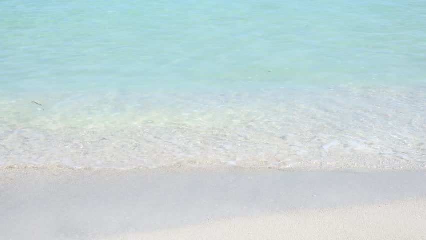 Varadero beach in Cuba featuring clear blue water and white sand, the beach is a tourist landmark, destination or attraction where thousands of people go for vacations in the Caribbean,