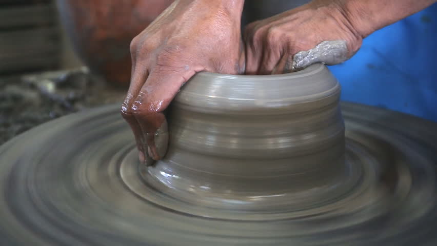 Close up of hands working clay on potter's wheel | Shutterstock HD Video #7641751
