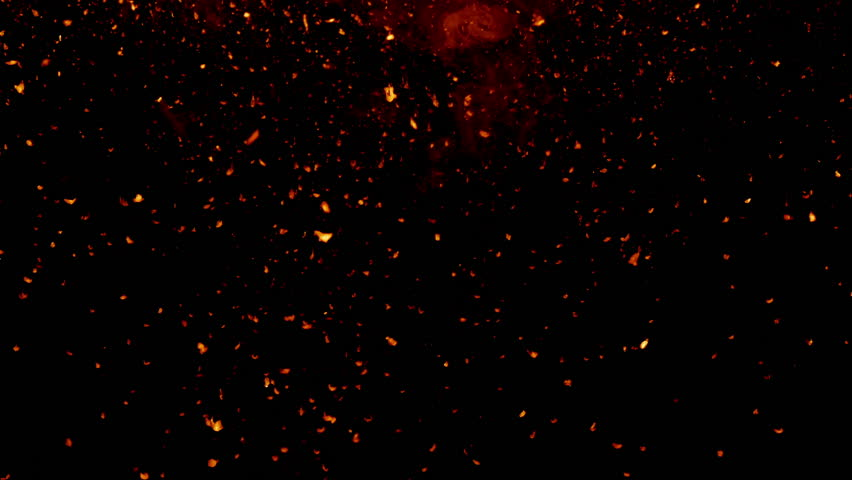 Red glowing falling particles, slow motion, on black background
