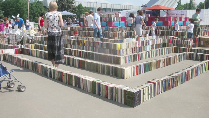 MOSCOW - MAY 24, 2014 (Time lapse): People walk in a labyrinth made out of books on Festival of Science and curiosity Polytech in VDNKH, Moscow, Russia on 24 May 2014.