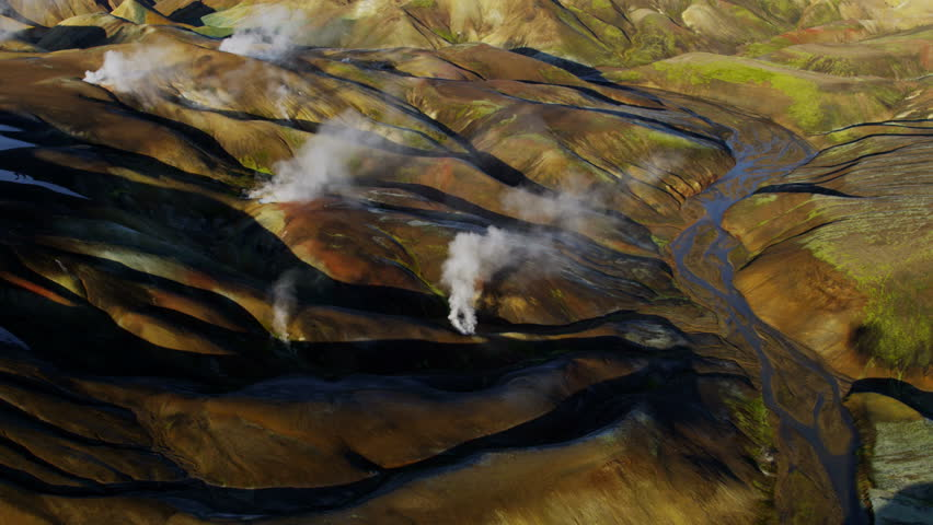 Aerial mountain mineral colors steam venting volcanic active area thermal energy Landmannalaugar region wilderness travel Iceland RED EPIC - 4K stock video clip