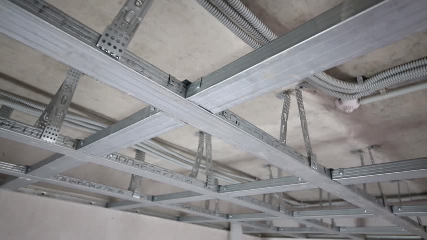 Metal framework for hung ceiling and tape rule in new flat Rules for painting ceilings