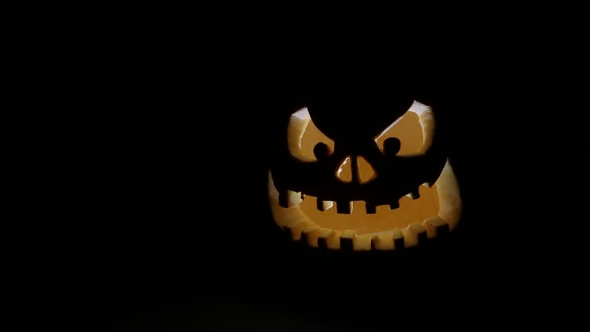 Carved Halloween pumpkin on a black background  | Shutterstock HD Video #7721779