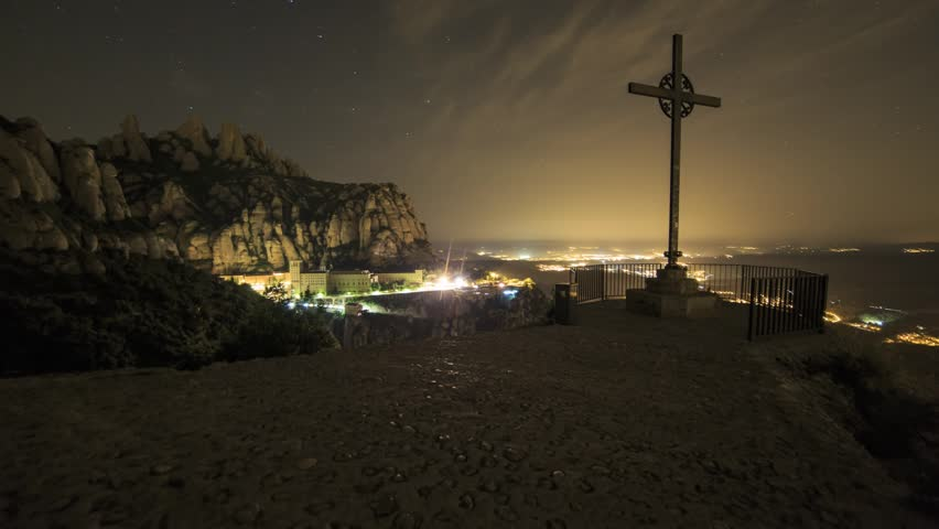 Crucifix / Cross at Montserrat just before sunrise.  Timelapse footage with dolly movement.