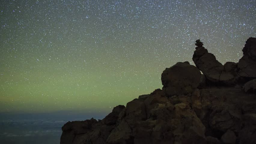 Night Sky timelapse with meteor and rocks on La Palma, Canary islands