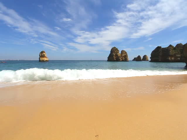 Waves on Rocky beach at summer, Lagos, Portugal | Shutterstock HD Video #7780738