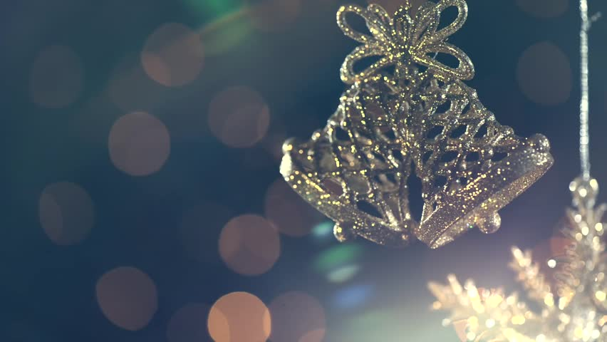 Christmas and New Year Decoration. Abstract Blurred Bokeh Holiday Background. Christmas bells baubles over Blinking Garland. Christmas Tree Lights Twinkling. HD 1080