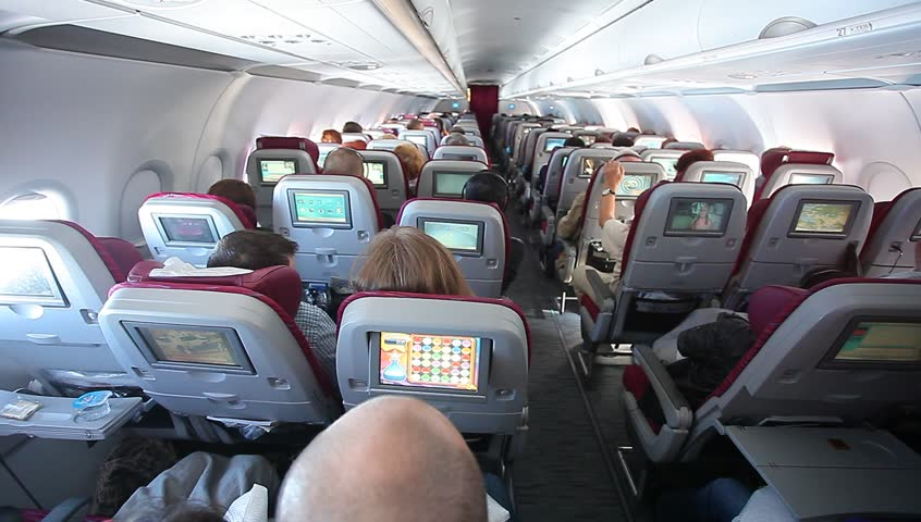 The interior of the aircraft Qatar Airways. Passengers on the plane.Russia, Moscow, March,15,2014