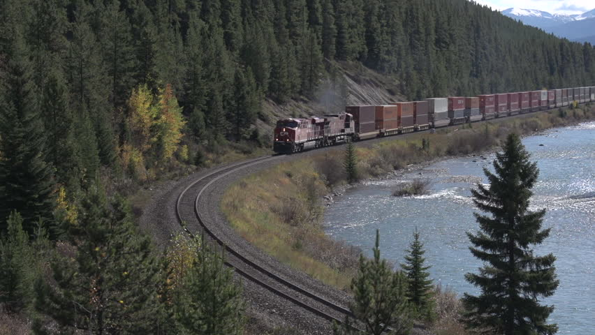 BANFF, ALBERTA, CANADA Oct 2012. A freight train passes through Morant's Curve