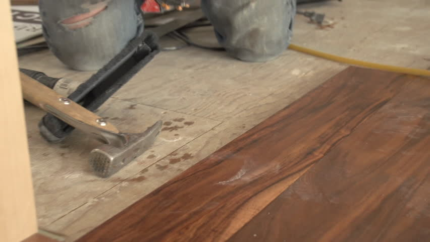 Home construction hardwood floor install stock footage for Columbia flooring canada