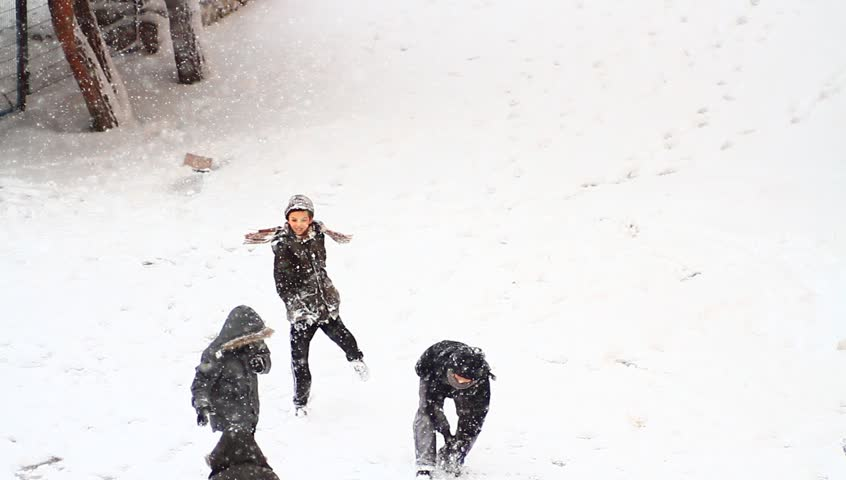 ISTANBUL - JAN 8, 2013: A giant snowstorm froze daily life as well as the streets all around the city. Snowball fight while its snowing